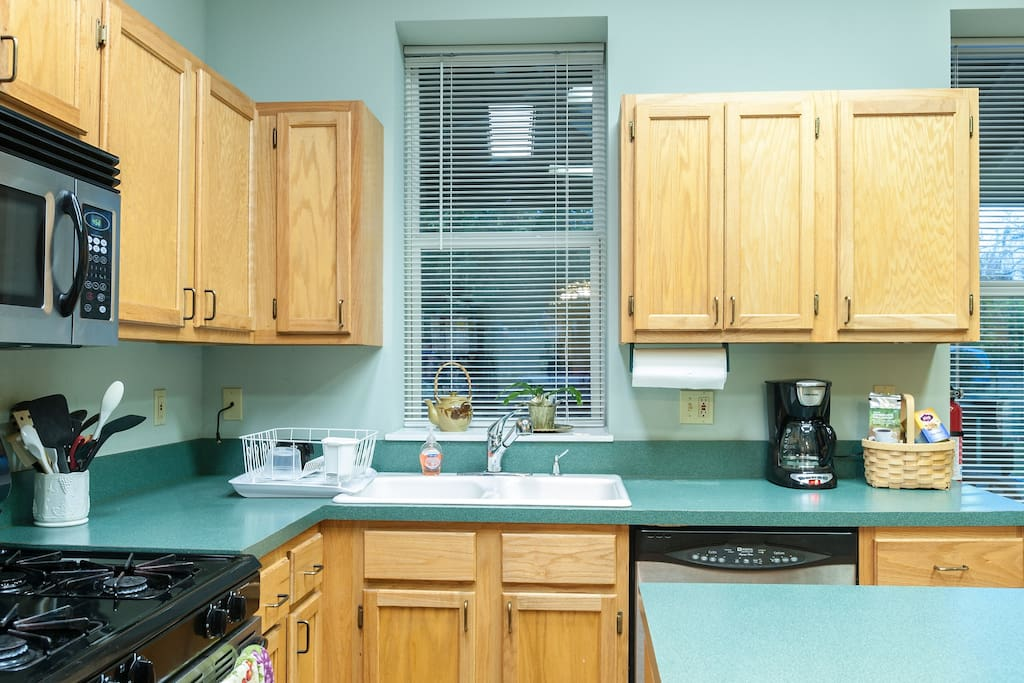 Prepare meals or grab a drink in our full kitchen featuring a dishwasher, oven/stove, microwave, and refrigerator.
