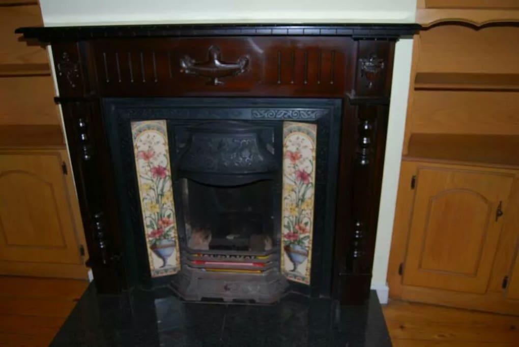 Cozy fireplace,  has table and chairs for dining but feel free to rearrange living/dining space.