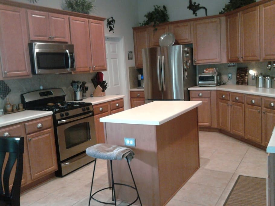 Large Island Kitchen  adjacent to Living Area