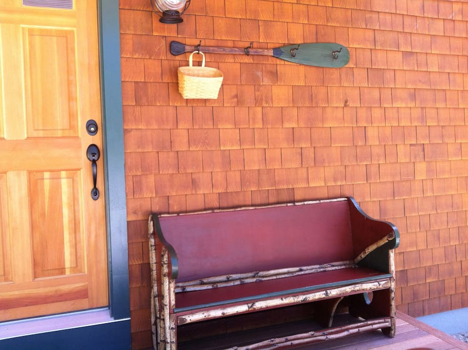 A Maine-ified old church pew to sit on  and view the sunset and a converted canoe paddle to hang your LL Bean fleece or windbreaker.