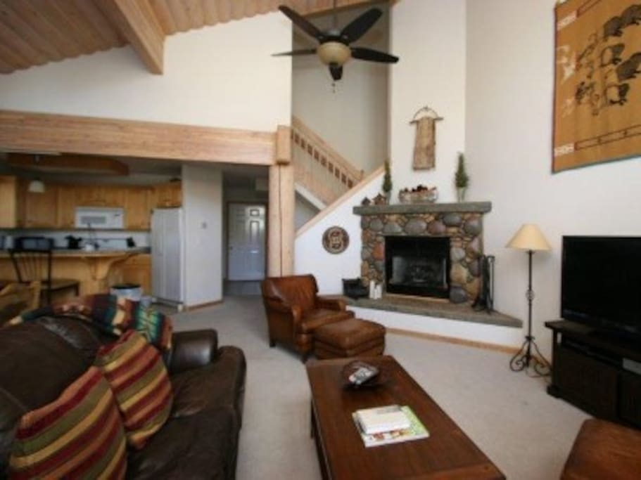 Great room enjoys large flat screen tv, comfy furnishings and gorgeous river rock gas fireplace. Sleeper sofa accommodates two additional guests for entire sleeping for eight in the home.