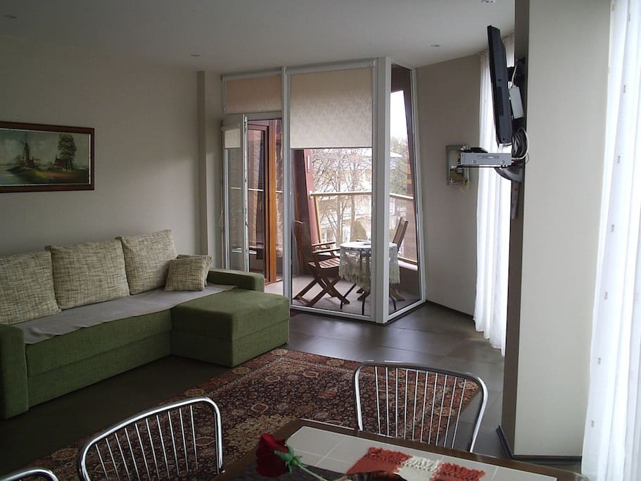 Own apartment's balcony with sofa for two guests, satellite TV.
