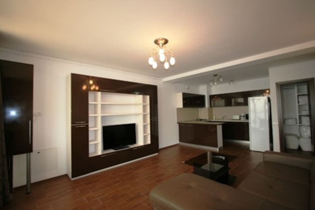 The living room is furnished and has modern facilities such as sofa in the living room, LCD TV , air conditioning, dining room .