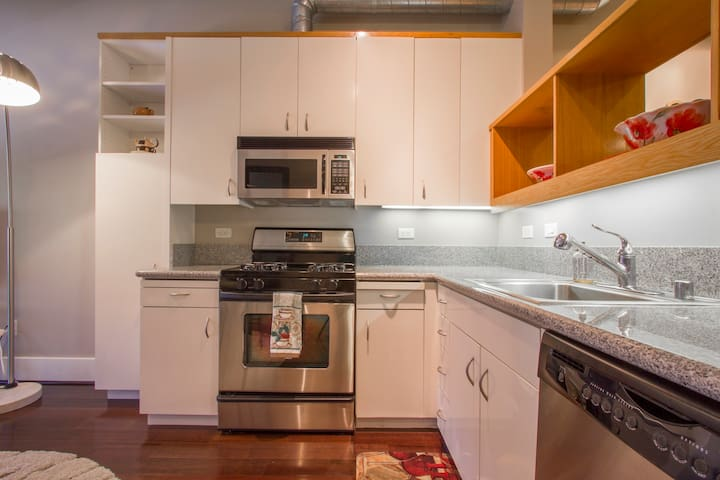 Fully equipped kitchen with all cookware and utensils