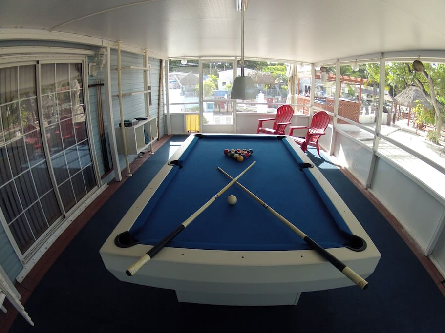 Play Pool in our outdoor screened patio