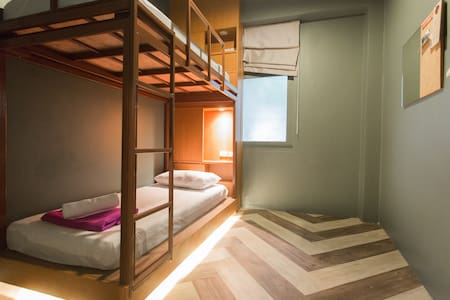 Our Private Twin Room- Bunk Bed are comfortable and modern. We have inspired by the concept of being clean, simple & affordable. Just 10 mins walk to Hua Lam Pong Station-MRT and China town. Less Than 5 mins walk to bus station and pier.