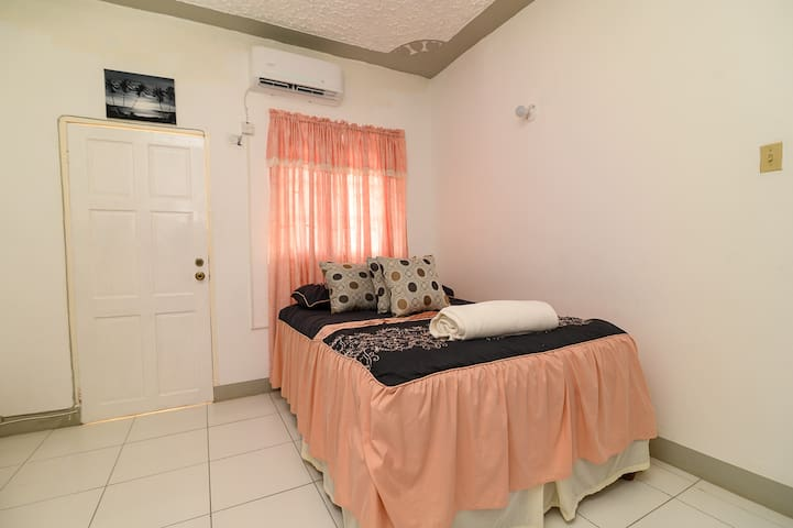 Master Bedroom in Roof Grande. The door you see leads to a back balcony.