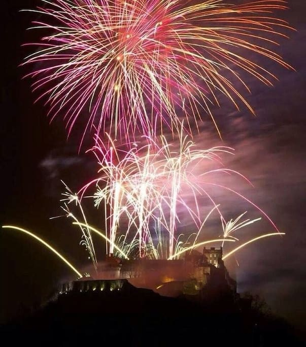 Firework display at Castle at New Year. As seen from the garden .