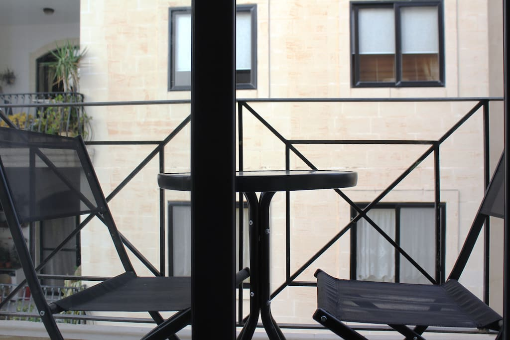 Nice balcony with table and chairs