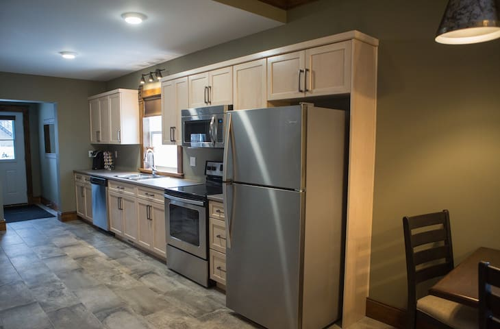 Kitchen   fridge . stove . dishwasher . microwave . keurig . dishes