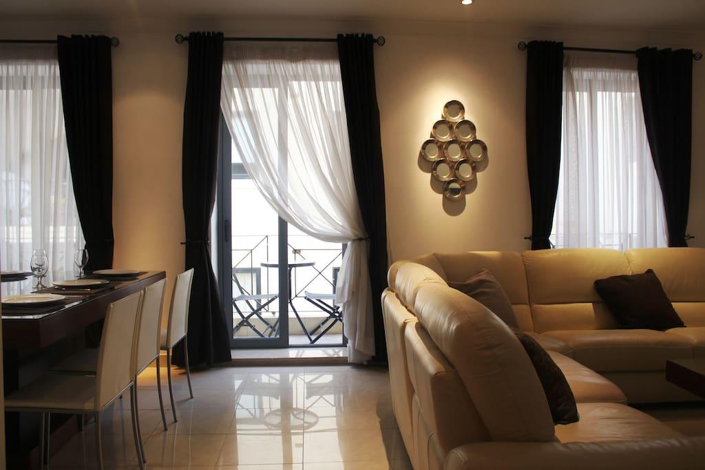 Stylish living room with 3 large windows