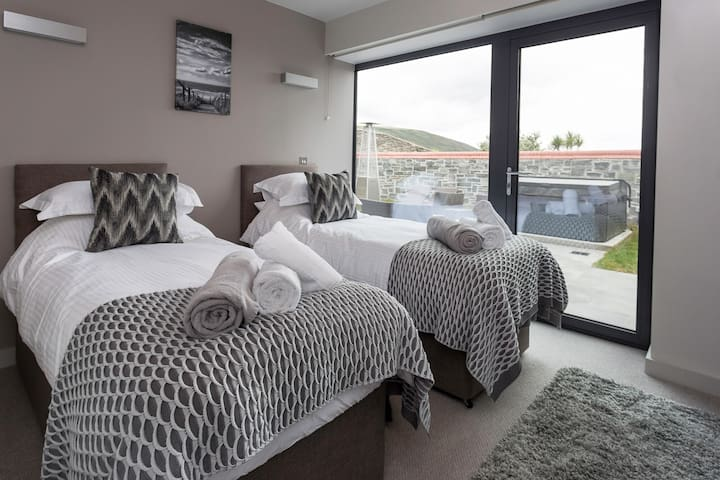 The twin room has access to the private terrace and the hot tub. (The twin beds can be made up into a king size bed upon request, prior to check in).