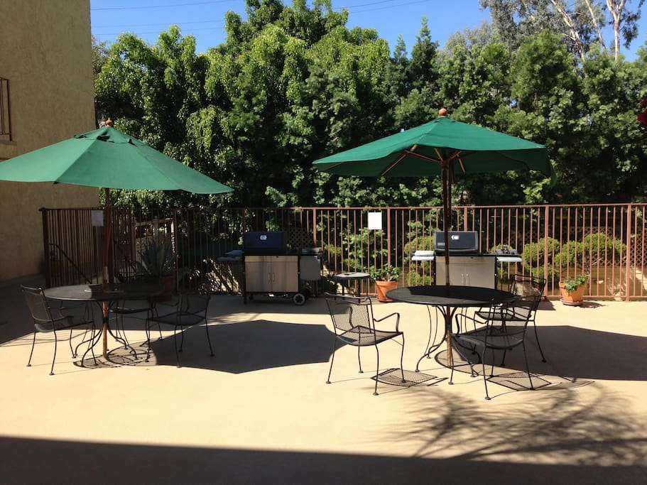 Common area with grill and patio furniture.