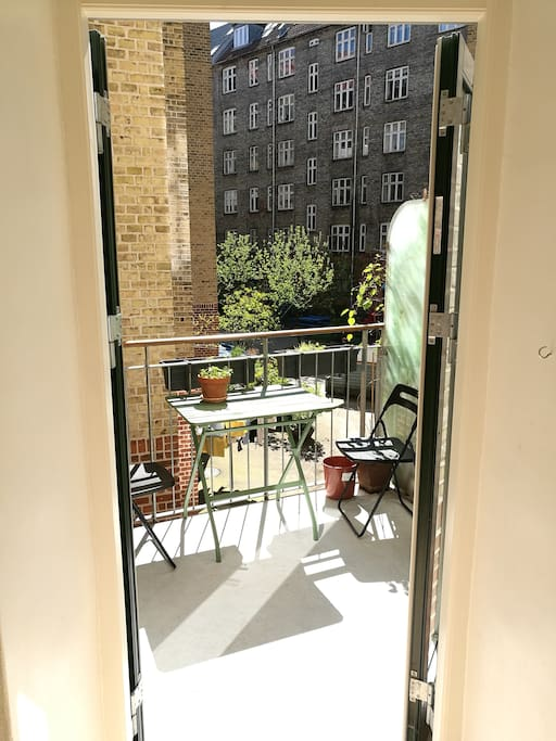 Rear balcony with stunning views onto rear court yard.