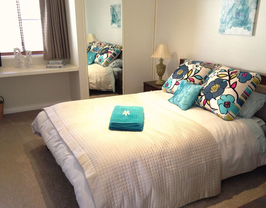 Coastal room with TV/DVD and comfortable queen bed.