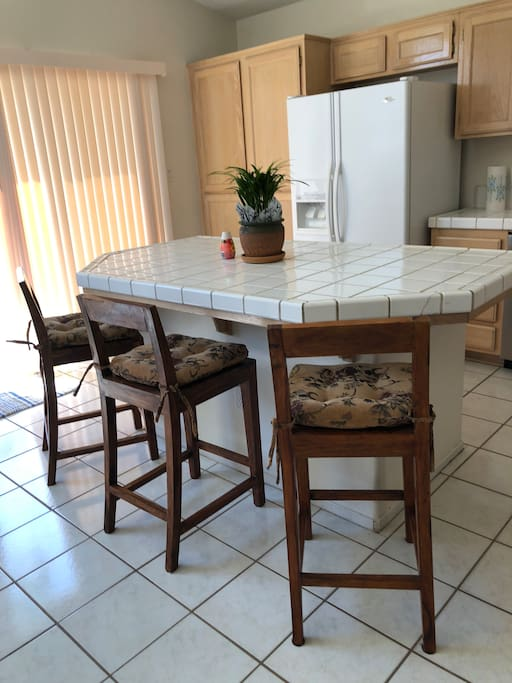 Kitchen island where breakfast is served.  Amenities for cooking are available if you prefer to cook your meals.