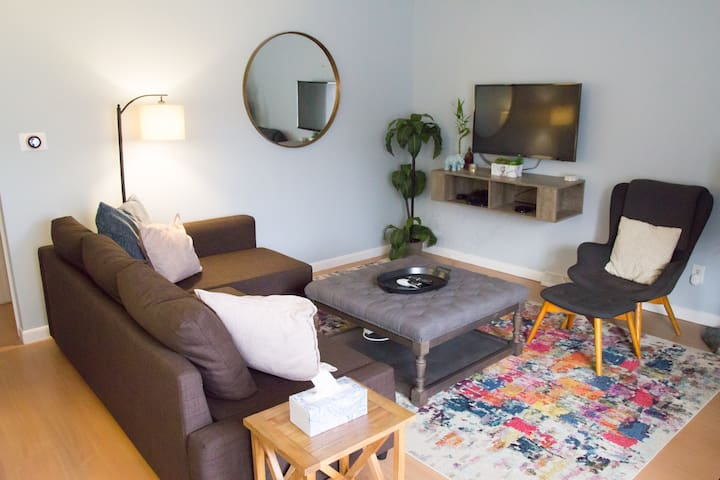 Both sides of this duplex feature a master bedroom and a super-cozy living room, each with a pullout bed (see later pictures for step-by-step), as well as fully-stocked kitchens, individual bathrooms, and a shared laundry room!