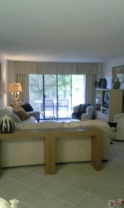Spacious living room w large sectional sofa and private back patio Wi-fi and cable included