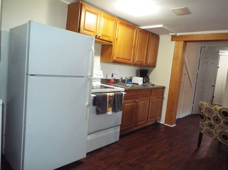 Kitchen area with full size appliances.