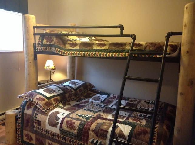 Double bottom bunk and a single upper bunk