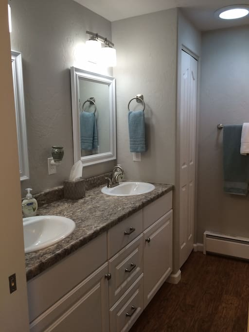 Full master bath with double sinks and pocket door for added privacy.