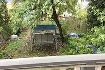 Backyard with swing (and rainwater collection cisterns)