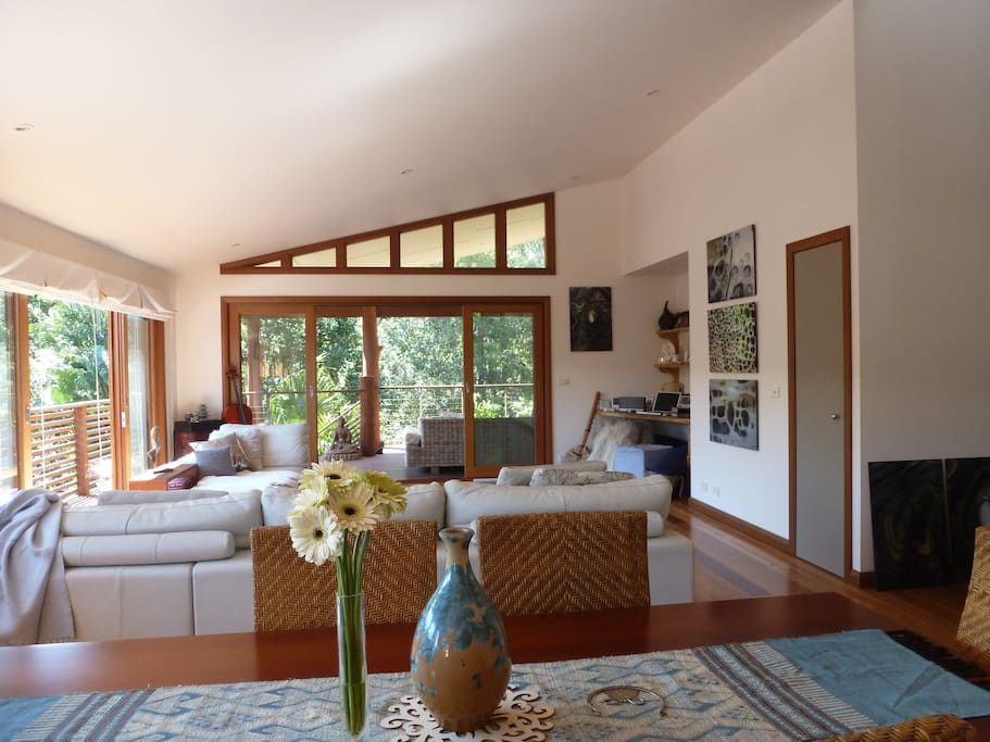 Open plan living area opening out onto  covered timber deck.