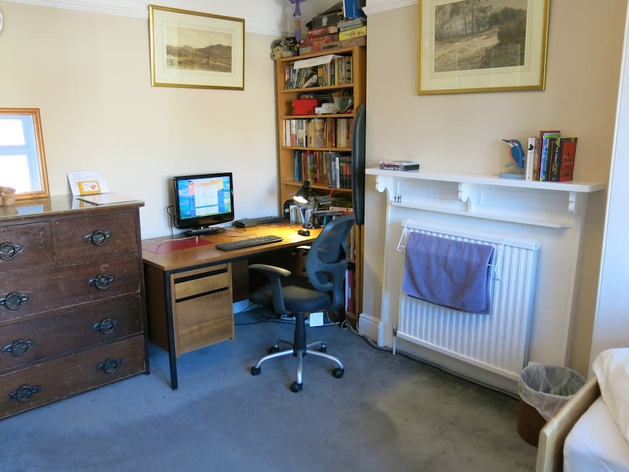 Comfortable study space, including desk, computer, DVD player and book/DVD collection