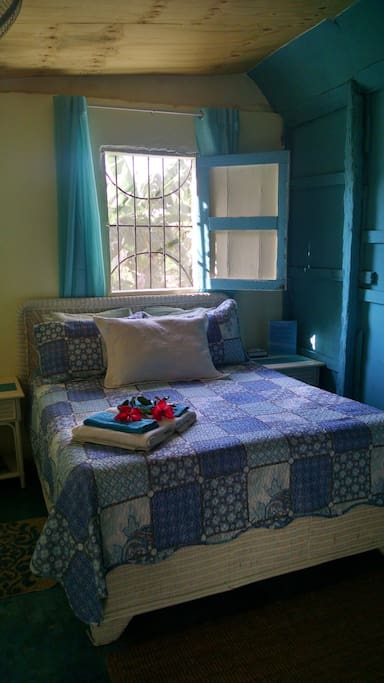 Private bedroom with locking door and private passage to shared bathroom. Bedroom has a new queen size pillow top mattress, night tables, drawers and hanging rack for clothes, wall mirror, hair dryer, fresh linens and towels.