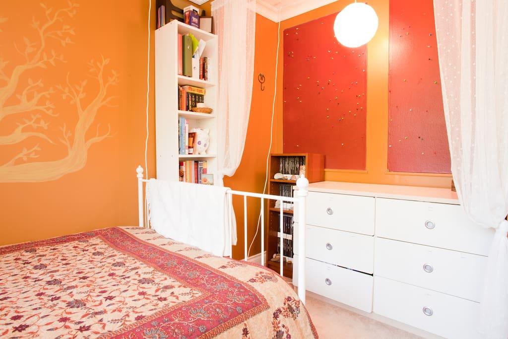 Artistic bedroom - dresser, bookcase & bulletin boards