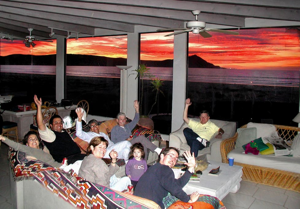 Guests enjoying the sunset from the living room.