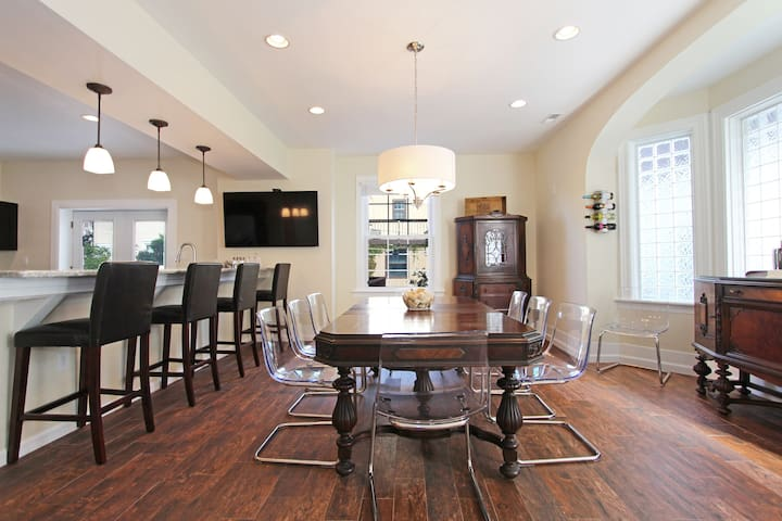 Seating for 18 in kitchen and dining area.