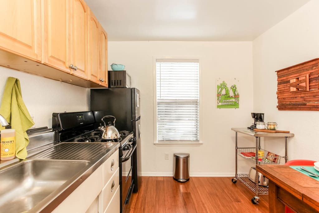 Separate full kitchen with stove/oven, refrigerator, microwave, coffeemaker, toaster.
