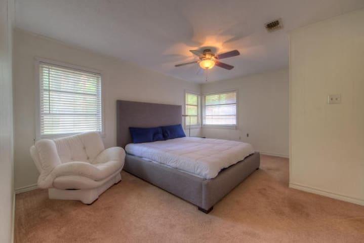 Junior master bedroom.  King size bed.