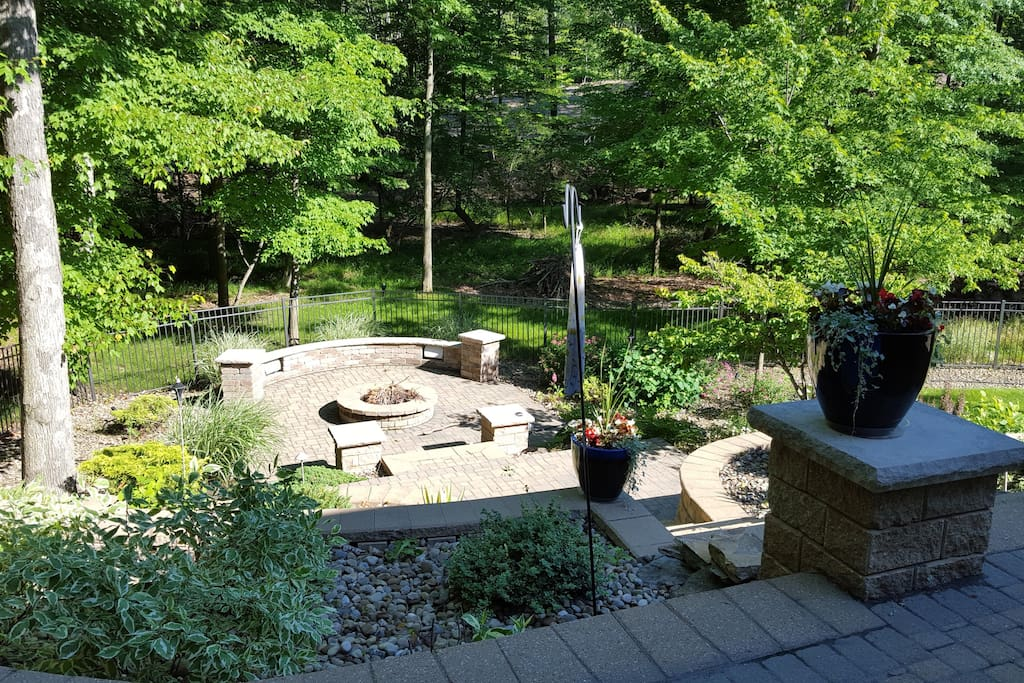 Lower patio view of tiered gardens and fire pit area