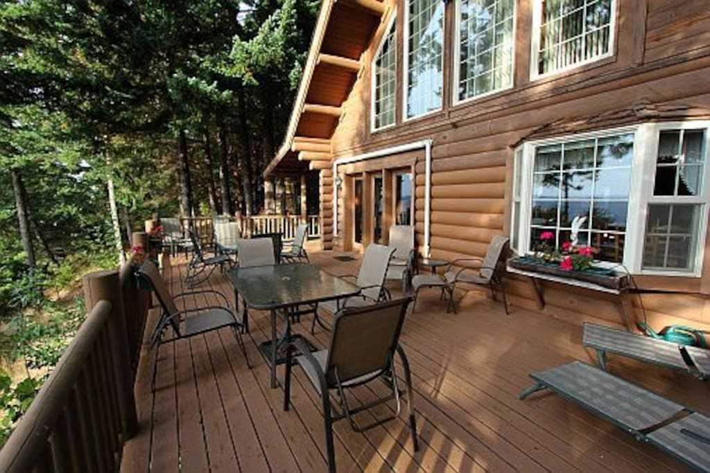 Wonderful outdoor entertaining with wraparound deck with two patio tables and seating areas