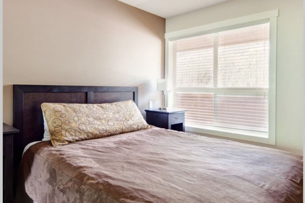 The bedrooms are furnished with comfortable beds