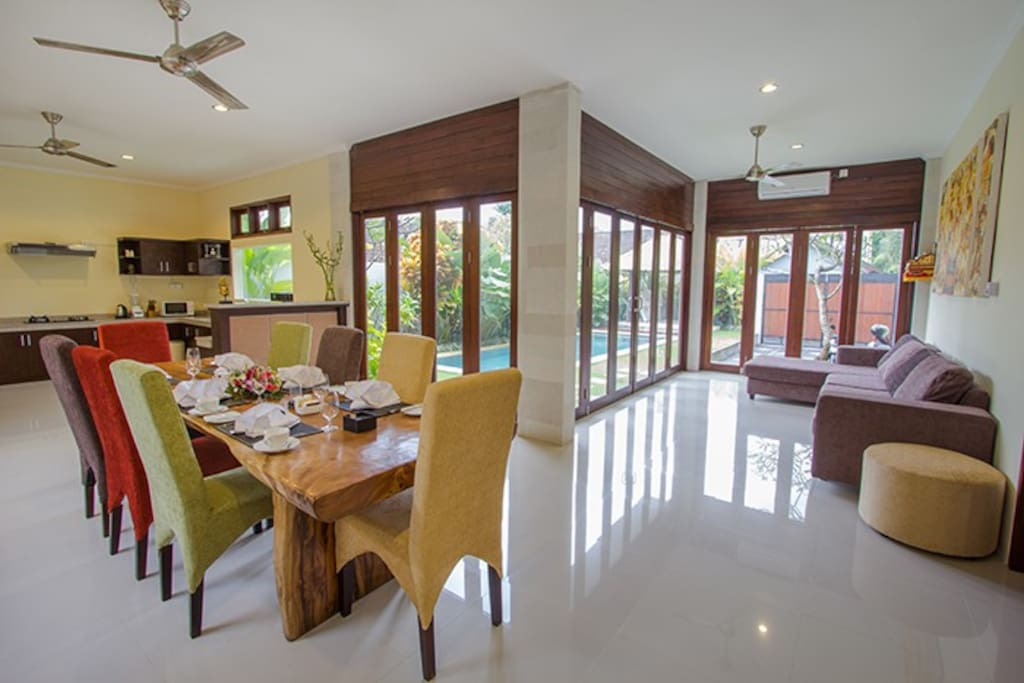 Family area with dining table, lounge, bar and fitted kitchen
