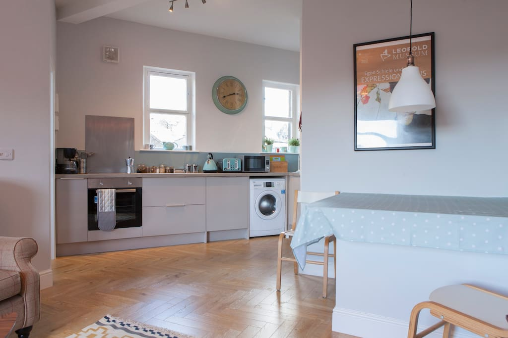 Open plan living and brand new, stylish kitchen... you can cook and socialise at the same time...