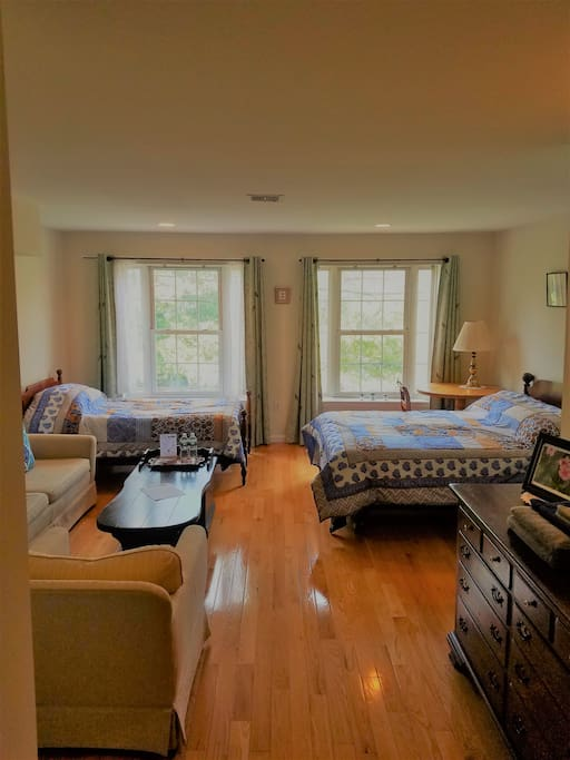 The second floor bedroom faces west and comfortably sleeps up to four guests.