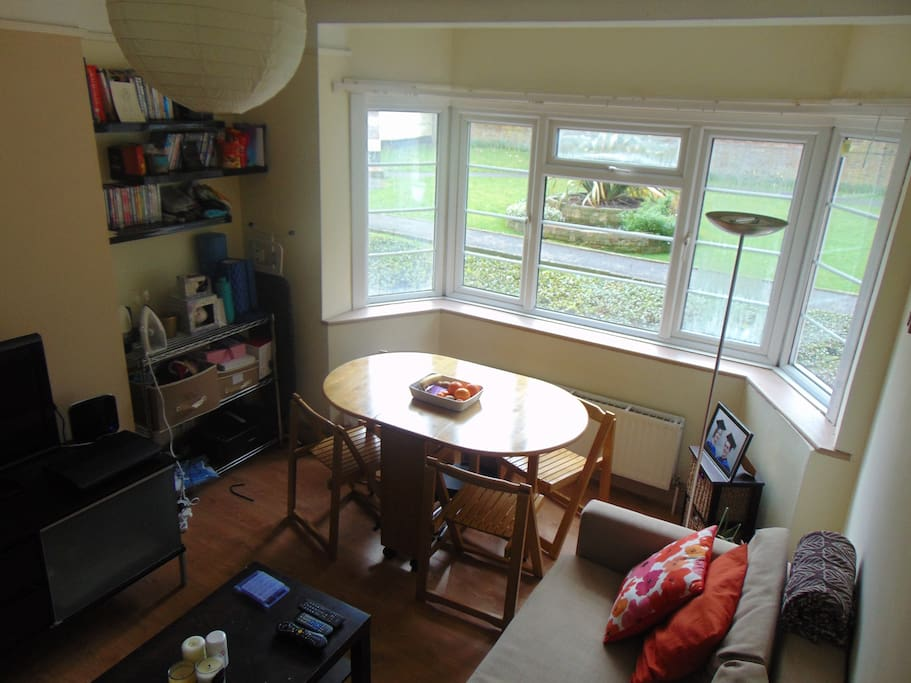 Sitting room: brand new double IKEA sofa bed, TV and DVD player, wooden table with chairs, wide bay windows with bright view on the lovely court and its garden