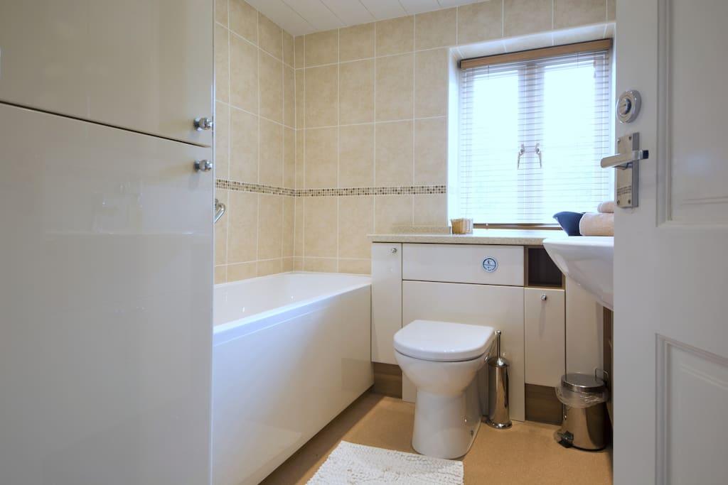 Full bathroom with shower over bath