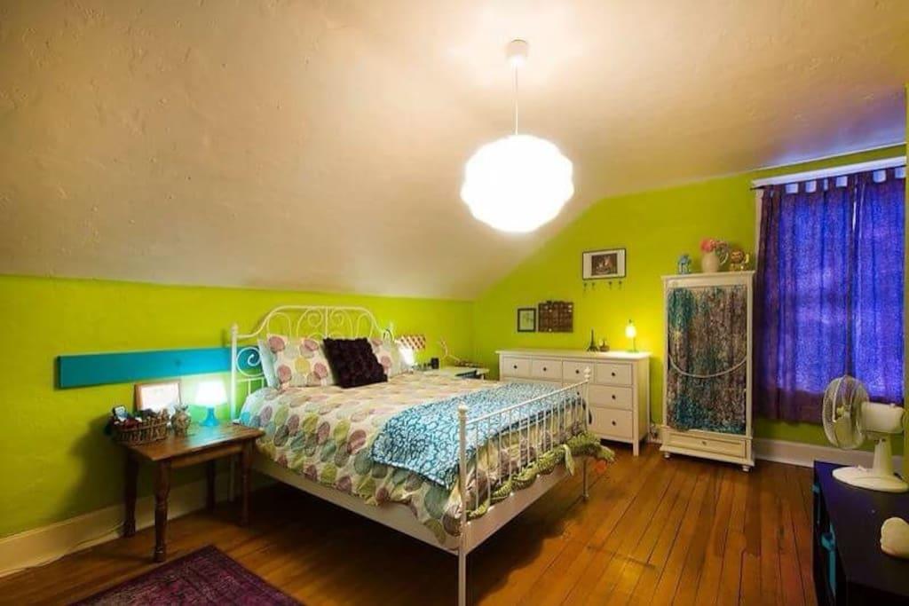 Large room with hardwood floors