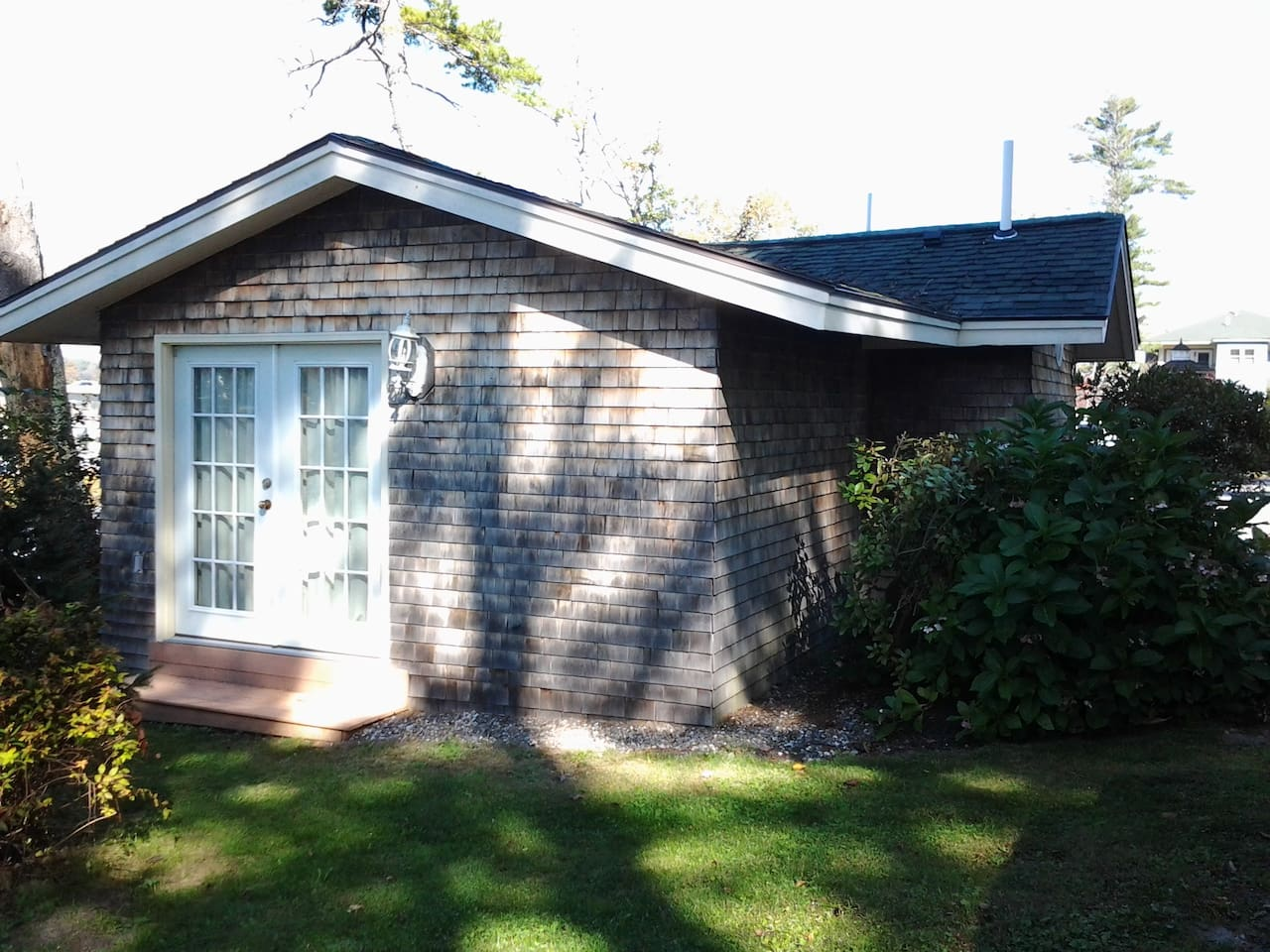 Exterior photo of back and side view of cottage.