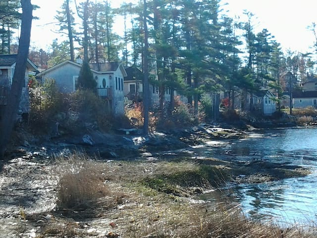 Cottage is the first on the left in this shot of the shoreline