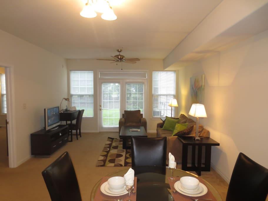 Spacious living room with dining area, entertainment center and convenient work desk