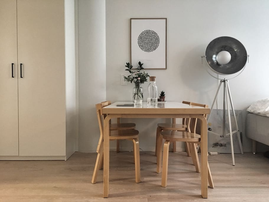 Artek table brings enough space to be comfortable for both eating and working.