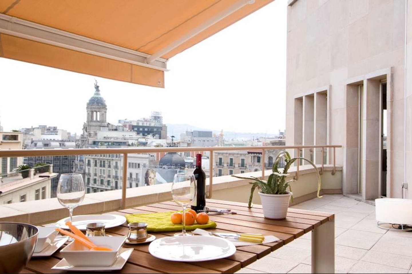 Enjoy the Barcelona skyline from the terrace.