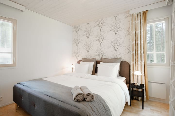 The master bedroom is filled with a large queen bed and topped with hotel quality linen for that perfect night's sleep