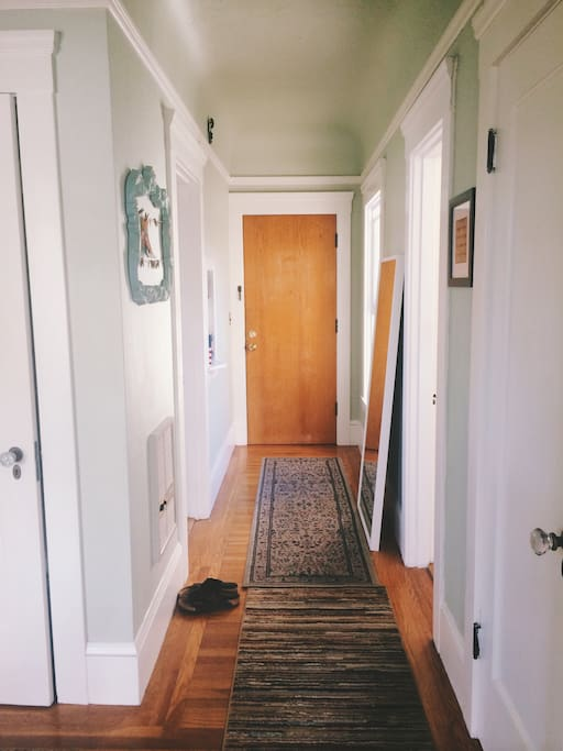 Hallway. Kitchen to the left. Full bathroom to the right.